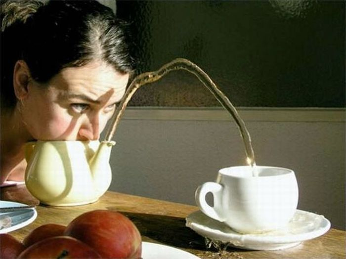 An unusual way to pour water to a cup of tea: 18