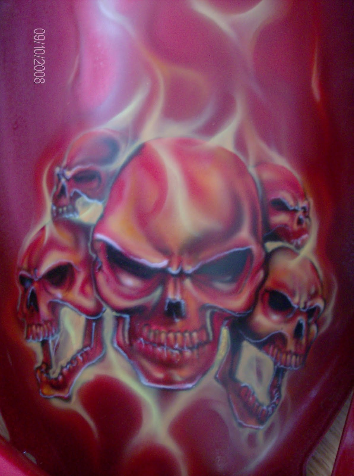 """""""Da Triggaman's Passion"""": Skulls With Flames On Red Coat Bike"""