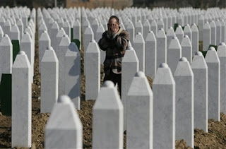 Bosnian Muslim man Huseinovic Hamdija says his prayer near grave stones at the memorial center of Potocari, near Srebrenica, 100 kms northeast of Sarajevo, on Sunday, Feb. 25, 2007.