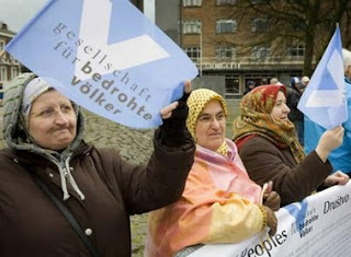 Bosnian women demonstrate outside the International Court of Justice in the Hague February 26, 2007. The highest U.N. court cleared Serbia on Monday of responsibility for genocide in Bosnia during the 1992-95 war, but said it had violated its obligation to prevent and punish genocide