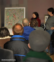 Amanda DeCort shares a map of Tulsa as Sarah Lobos look on.