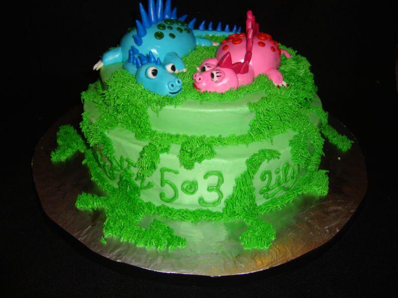 Cake Lane Two Dino Siblings on a Cake