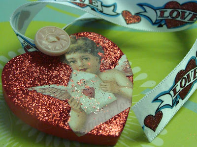 Decorated Wood heart with cherub, button, ribbon and glitter. How to decorate wood hearts. DearCreatives.com
