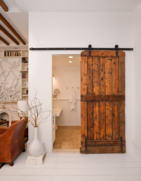 using a barn door in decorating pocket door solution