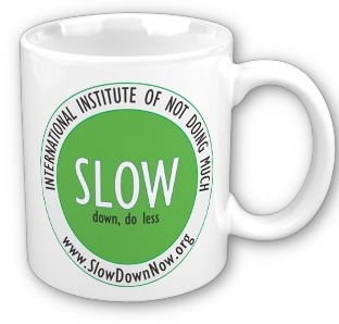 coffemugthat says Slow Down, Do Less