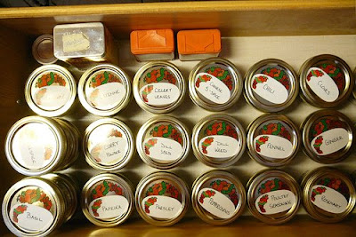 labeled spice containers in drawer