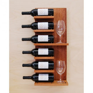 wall mounted wine rack with six bottles