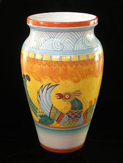 umbrella stand made from Majolica Italian pottery; bird of paradise pattern