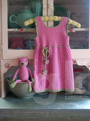pink little girl's dress on hanger