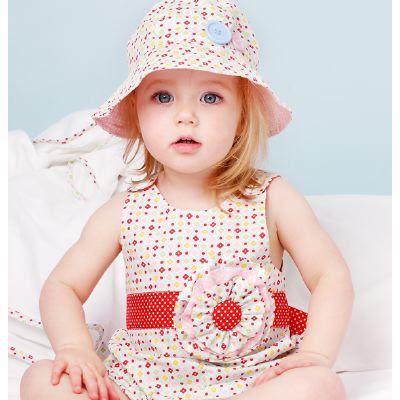 little girl in party dress and hat