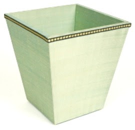 wastebasket covered in pale green fabric