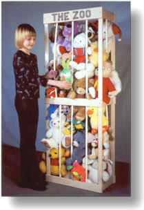 cage for stuffed animals - filled with plush toys