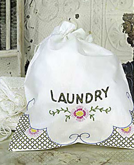 laundry bag embroidered with word laundry and some flowers