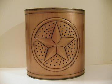 tin oval wastebasket with Texan lone star design