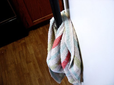 kitchen towel on refrigerator door handle