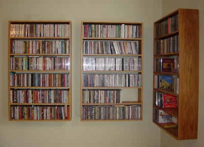 wall-mounted shelf holding 330 CDs
