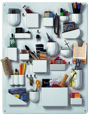 plastic organizer for the wall with many different-sized pockets