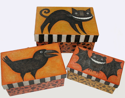 3 handpainted nesting boxes with crow, bat, cat
