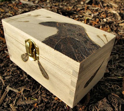 woodburned box with image of a crow