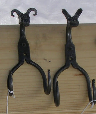 hooks with animal faces, made by blacksmith