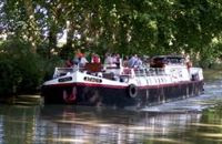 Enjoy the French Canals aboard the hotel barge ATHOS - Contact ParadiseCoonections.com