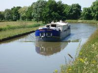 French Hotel Barge Enchanté cruises south. Book with ParadiseConnections.com
