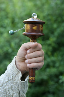 wooden handheld prayer wheel
