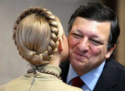 EU Commission President Jose Manuel Barroso kisses Ukraine's Prime Minister Yulia Tymoshenko goodbye after a meeting at the EU Commission headquarters in Brussels, Monday Jan. 28, 2008. (AP Photo/Geert Vanden Wijngaert)