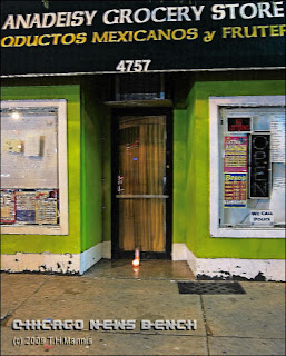 A candle burns in the doorway of Anadeisy Grocery