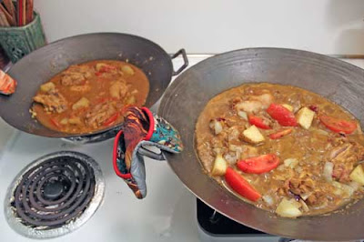 Malaysian Chicken Curry cooked in two cast iron woks.