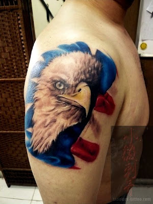 A typical American symbol eagle tattoo. The color of this tattoo is vivid,