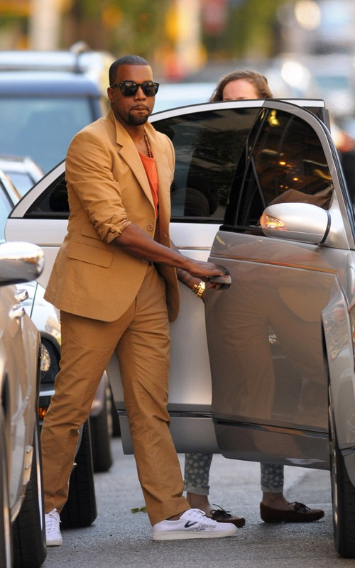 0d8b010c1972 Kanye West tweeted to his fans about the decision to wear his camel colored  Prada suit over an all white suit for the last official day of summer.