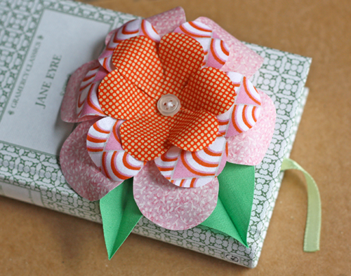 Fabric flower tutorial how about orange a few people asked how to make the flower on yesterdays fabric origami box this is an easy craft project thats a good way to use up scraps mightylinksfo