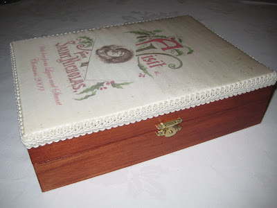 Covered box with Santa image on the top, used silk fabric and trimmed around the edge