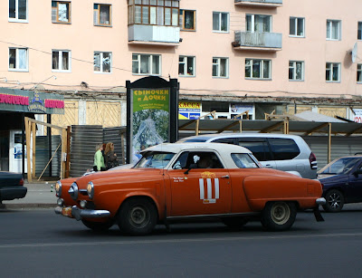 1958 ford cars » The Siberian city Omsk  06 11 07 Number 111 on a street  1951 Studebaker Starlite Coupe