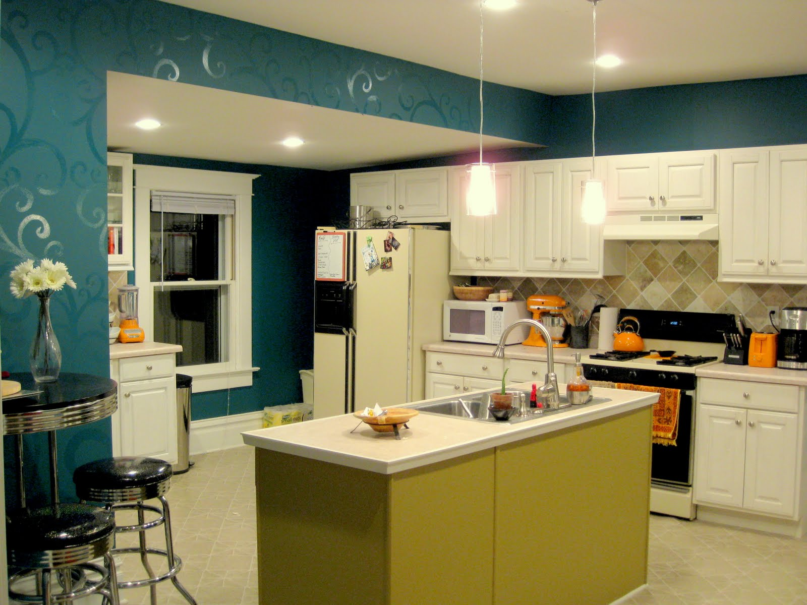 Remodelaholic kitchen before and after decorative painted walls but man changing the lighting to recessed can lights made a huge difference i feel like my kitchen glows and it does literally enjoy amipublicfo Image collections