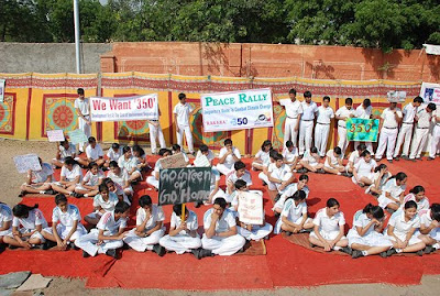School children at rally in 350 formation.