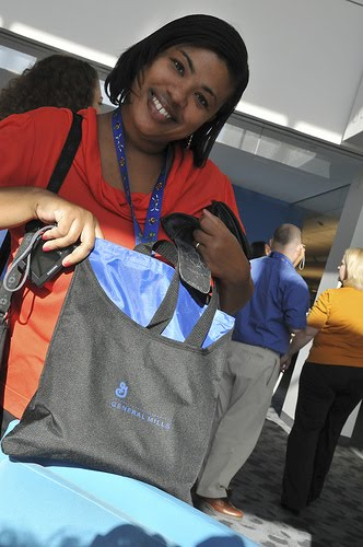 a woman smiling holding at blue bag at General Mills headquarters