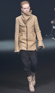 3e2d45f6a03e ... from the Fall 2010 Collection. This paneled leather jacket features a  high neck snap button collar