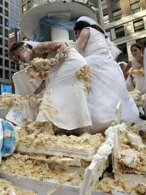 Crazy Funny Photos  Funny Massive Wedding Cake Fight Wedding Cake Fight  Its not often you see a wedding cake this big  But then  to see a whole lot of brides amongst it engaged in a fight  well thats just  too