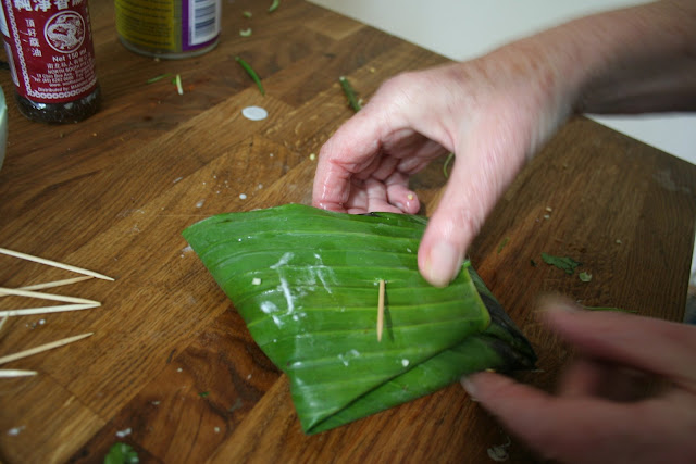 wrapping fish in A banana leaf