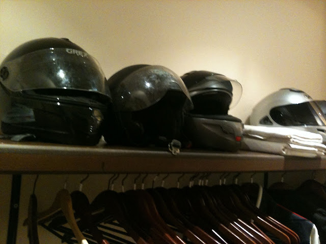 Helmets lining the cloakroom. Even businessmen are on scooters, la regaled restaurant, paris