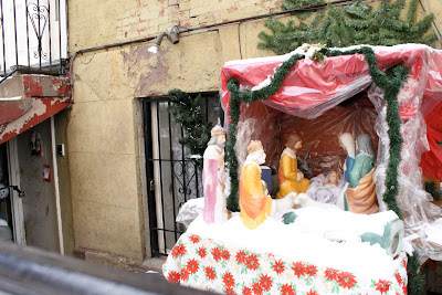 A snowy creche on the streets of New York