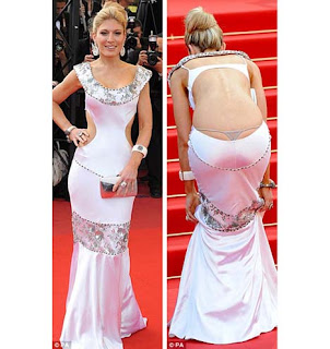 aecc885c68 A socialite Hofit Golan é apelidada de a Paris Hilton israelense. Ao se  curvar e puxar o vestido para enfrentar a escadaria no Palais des  Festivals