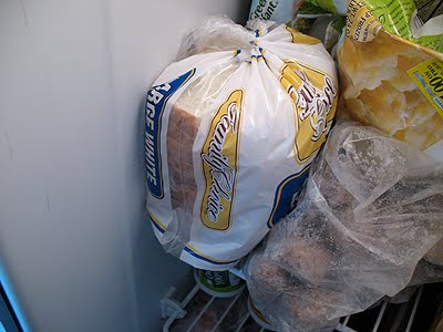 A close up photo of a loaf of bread in the freezer.