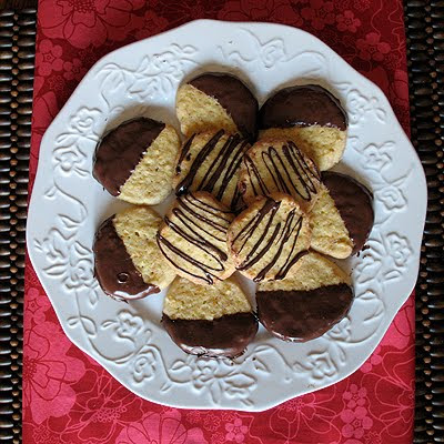 An overhead photo of toasted coconut orange icebox cookies on a plate.
