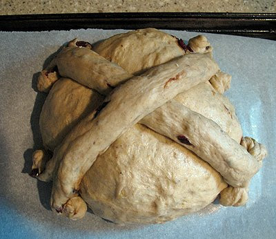 A photo of the remaining dough formed into ropes and put on top of the dough ball.