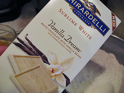 A close up photo of a box of Ghiradelli Vanilla Dream white chocolate with vanilla beans.
