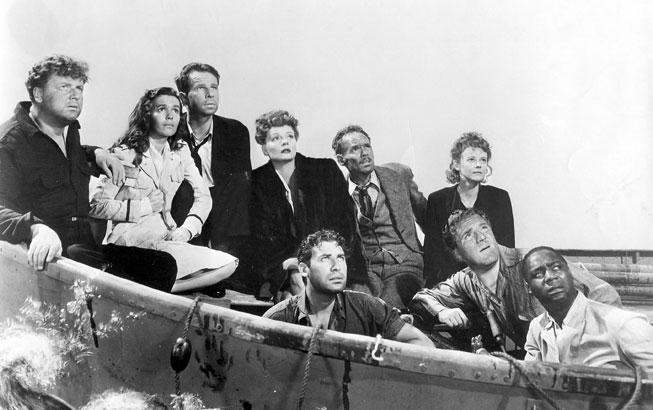 Original still from Lifeboat. From left: Walter Slezak, Mary Anderson, Hume Cronyn, Tallulah Bankhead, John Hodiak, Henry Hull, Heather Angel, William Bendix, Canada Lee. Twentieth Century Fox Film Corp./Photofest.