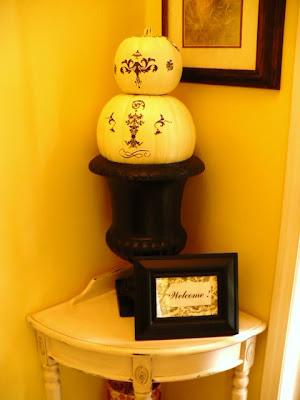 white pumpkins in black urn